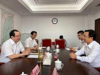 譚俊榮與山西省副省長王一新(左一)會談